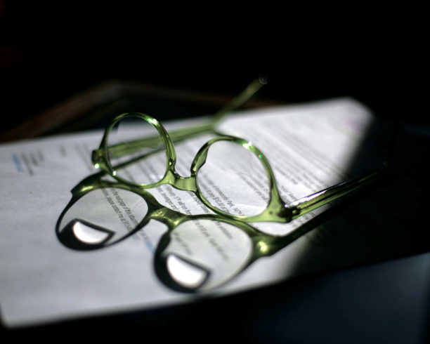 reading glasses and some content for a new marijuana business that might need a cannabis investor