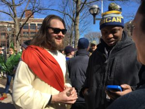 Man dressed like Jesus at Hash Bash, giving away Michigan marijuana