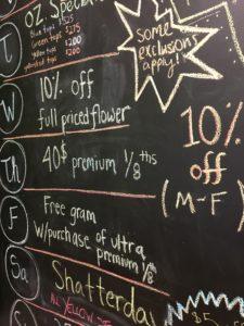 chalkboard in a marijuana provisioning center