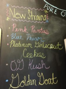chalkboard menu in a dispensary