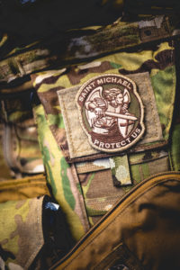 photo of combat fatigues and a St. Michael patch