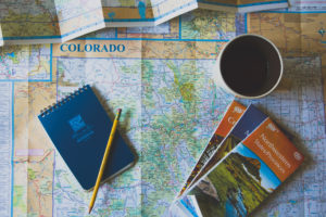 photo of a colorado map and notebook