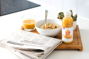 a newspaper and a breakfast tray