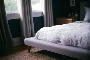 a comfy looking bed, where someone might consume cannabis for sleep