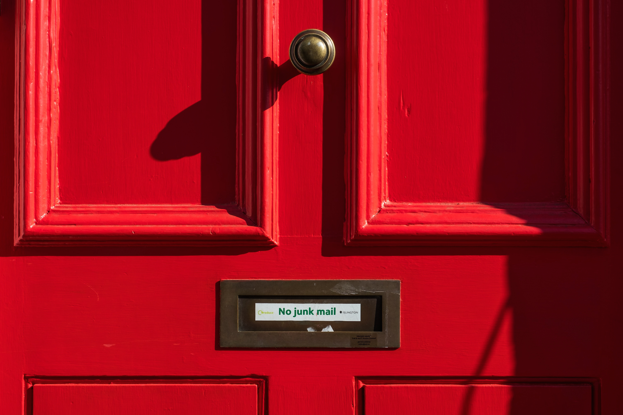photo of a red door with no junk mail written on it to illustrate using email for your cannabis business, but not spamming