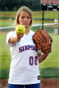 young woman with a softball to illustrate a pitch to the media of a cannabis business story