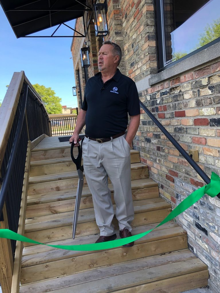 photo of Greg Maki at the grand opening of his provisionary center. Cannabis PR helped make the event a success by using PR for promoting a cannabis brand